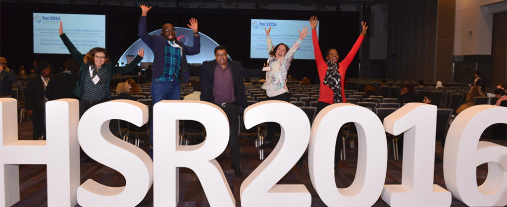 Conference goers jumping for joy